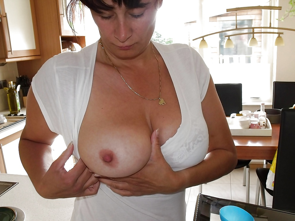 Chubby mature patient reveals her saggy breasts to a surveillance cam