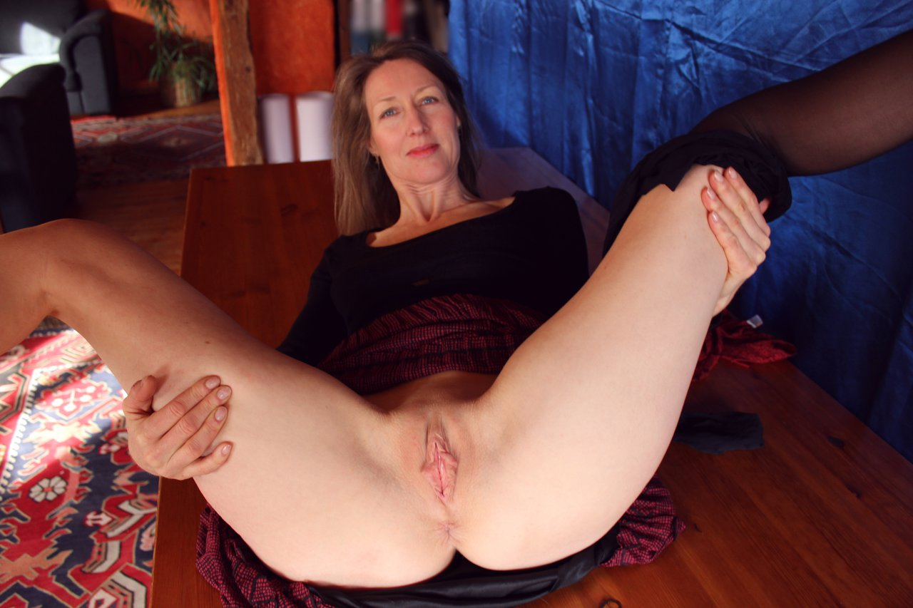 Busty Mature Babe Strips And Spreads Her Shaved Pussy