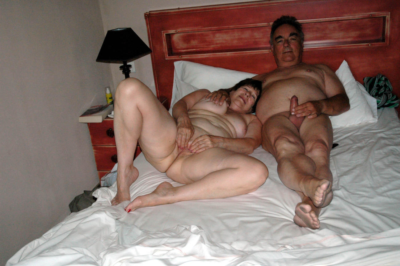 Nude fat couple in bedroom