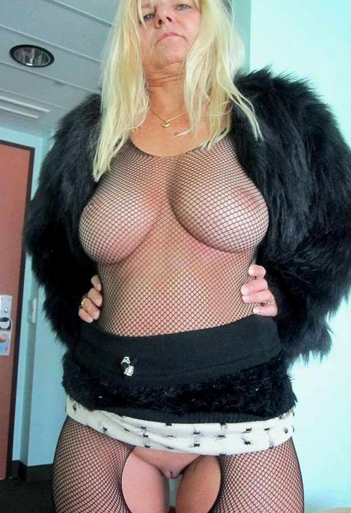 Fat blonde granny posing in various erotic outfits