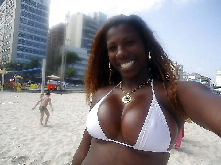 Super sexy black MILF with big tits and big ass on the Brazil beach
