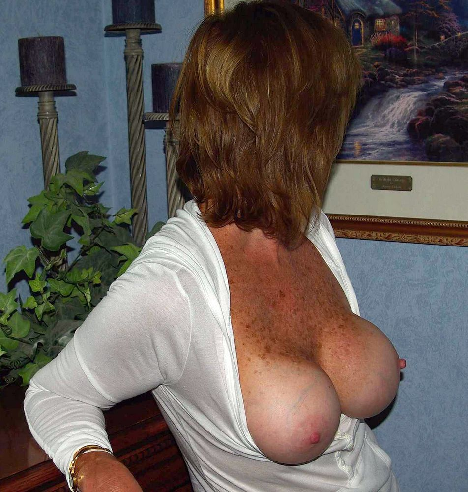 This leggy mature lady hides her face, but shows juicy big breasts