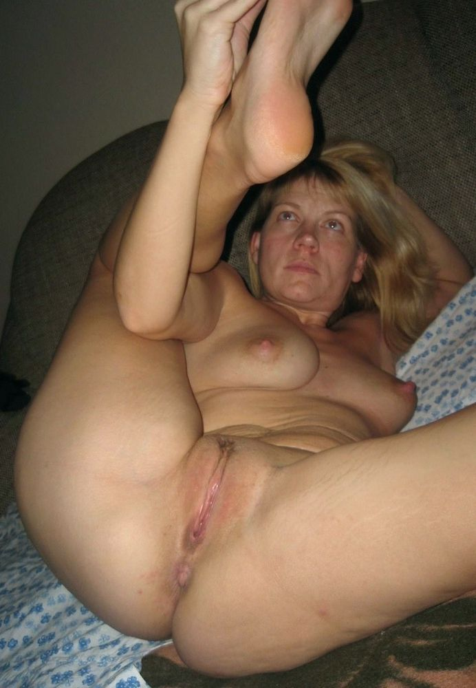 Totally naked mature ex-wife posing at home