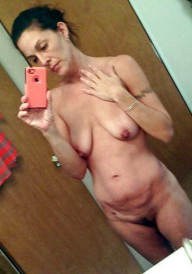 Nude old women take self-shot pictures being naked in the bathroom