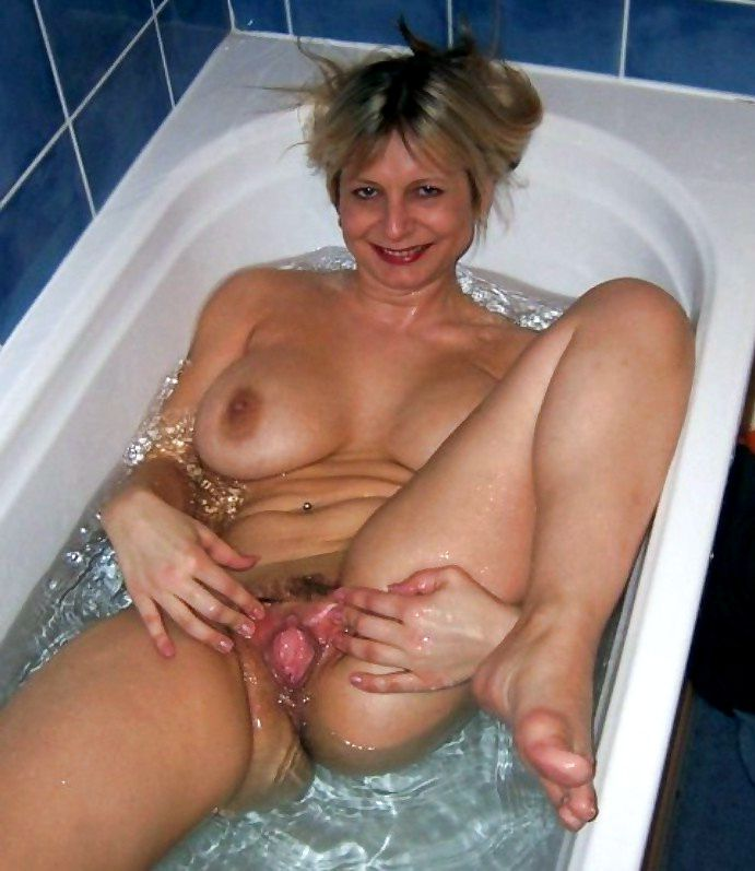 Mature women homebodies open their pussy lips
