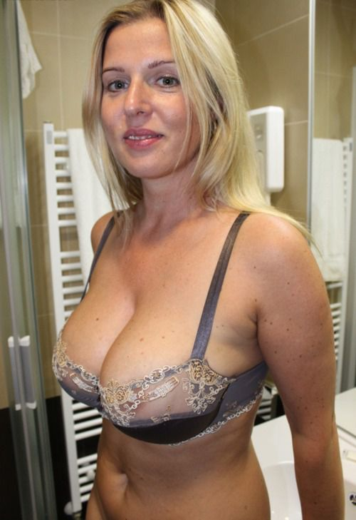 Charming mature wife in tempting black lingerie