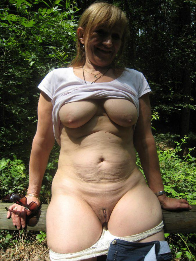 Luscious blonde mom dressed in a transparent grid