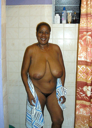 Curvy black mom wipes his body with a towel