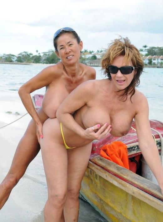 Busty asian granny MINKA lesbian sex on the beach