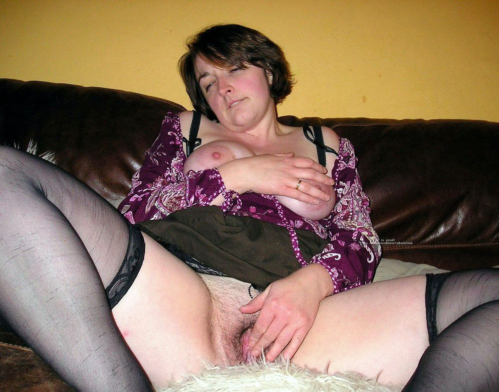Busty plump MILF in stockings brags of her thighs