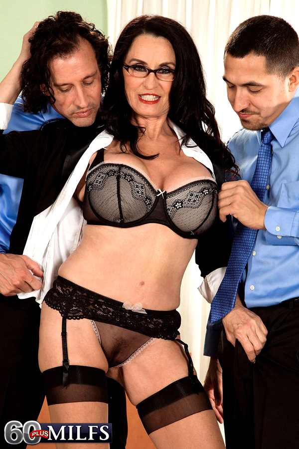 Hot mature Rita in glasses and lace lingerie sucks cock in office 3some